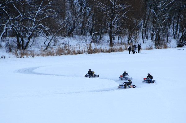 group of people snow karting