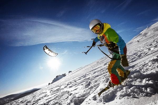 A man snowkiting