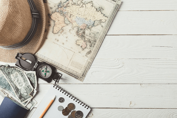 travelling essentials including map, compass, money and sun hat